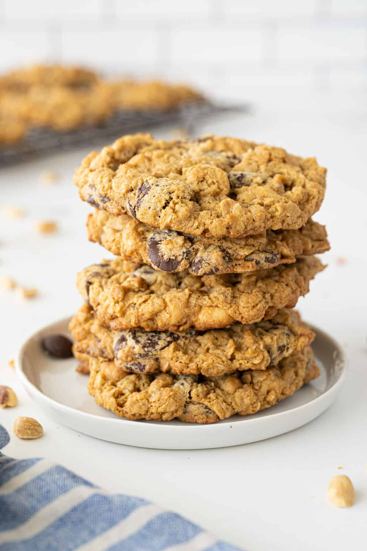a stack of Peanut Butter Oatmeal Cookies on a white plate on a white plate