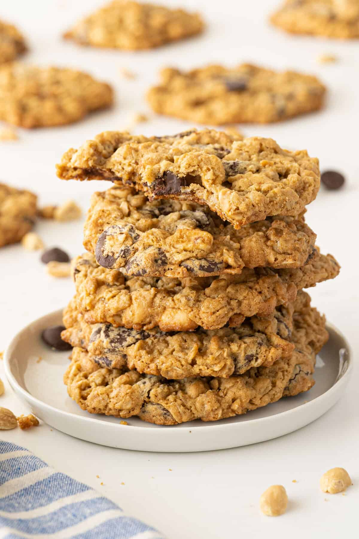 Peanut Butter Oatmeal Cookies on a white plate with a bite out of one cookie