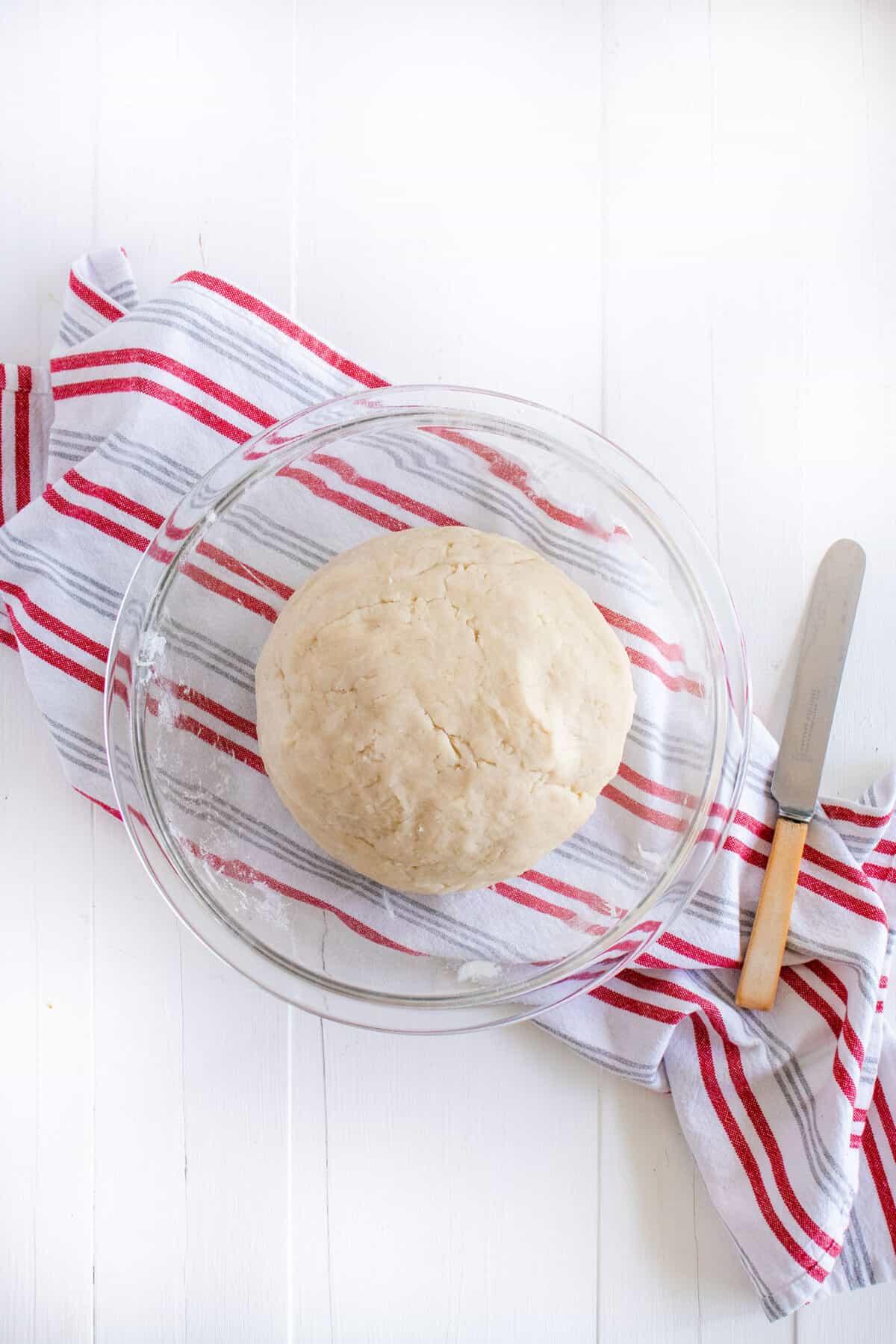 pie crust dough in a ball in a clear bowl