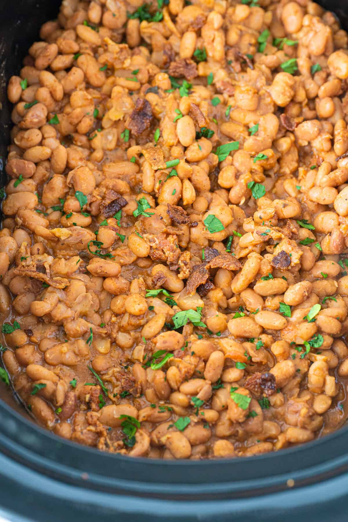Ranch style beans in a black slow cooker