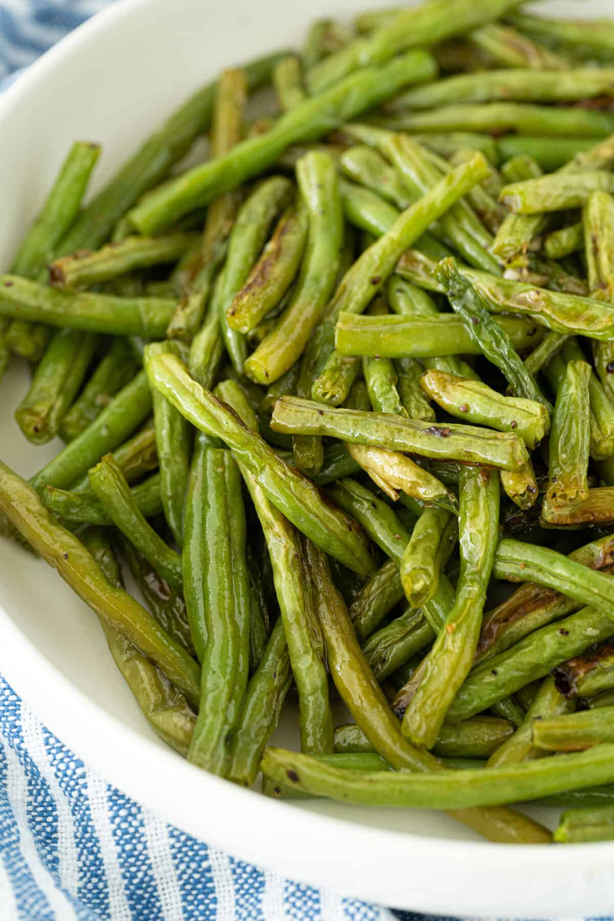 roasted green beans in a white bowl