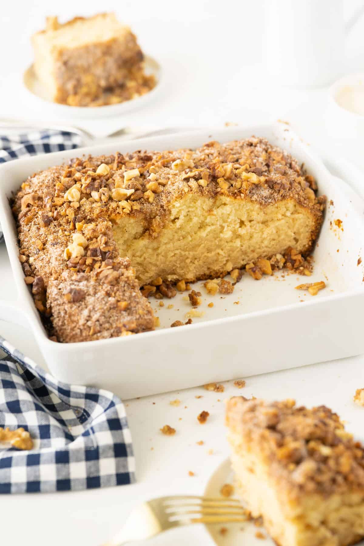 pan of sour cream coffee cake with a slice taken out