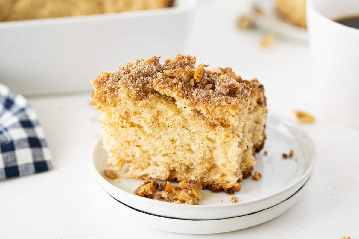 slice of sour cream coffee cake on a white plate