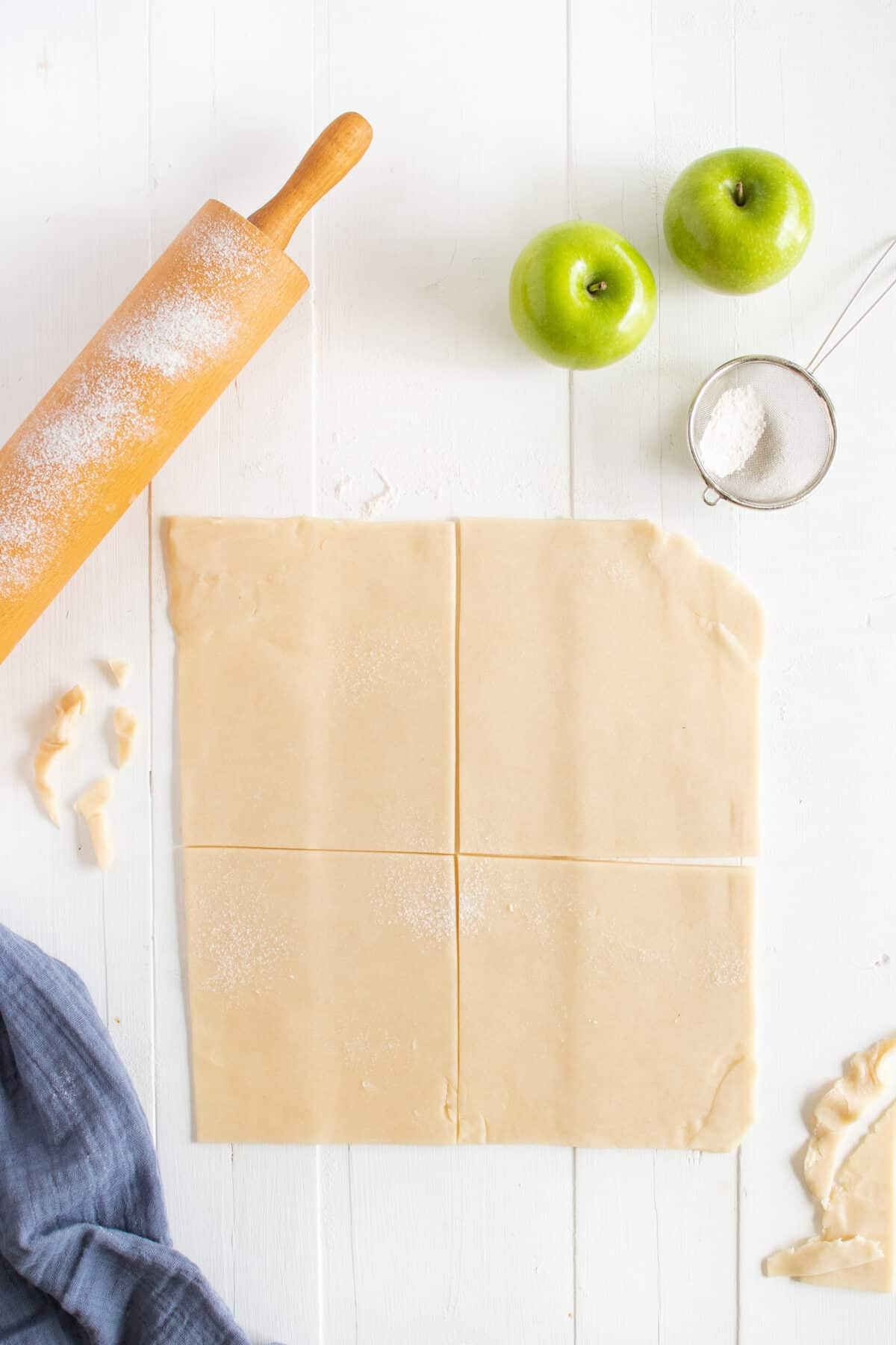 cutting the pastry into four squares