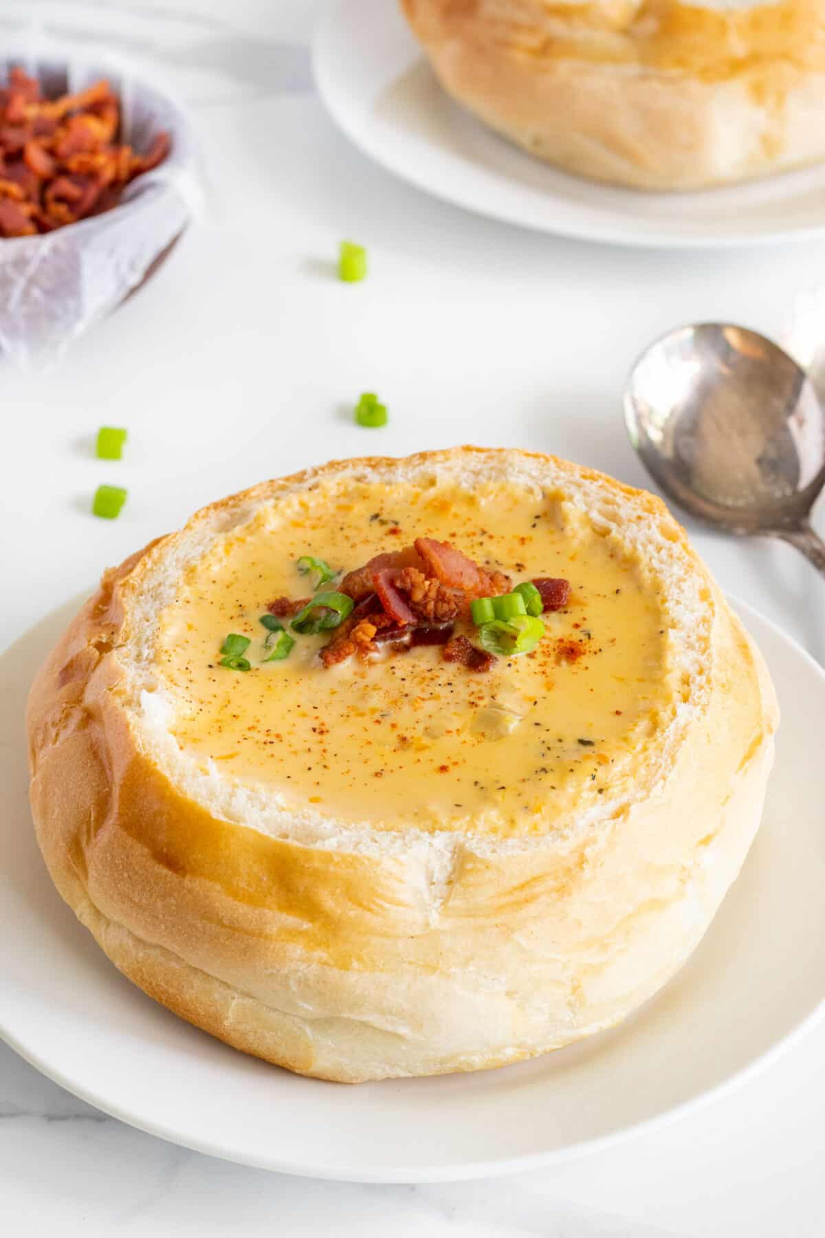 close up of beer cheese soup in a bread bowl