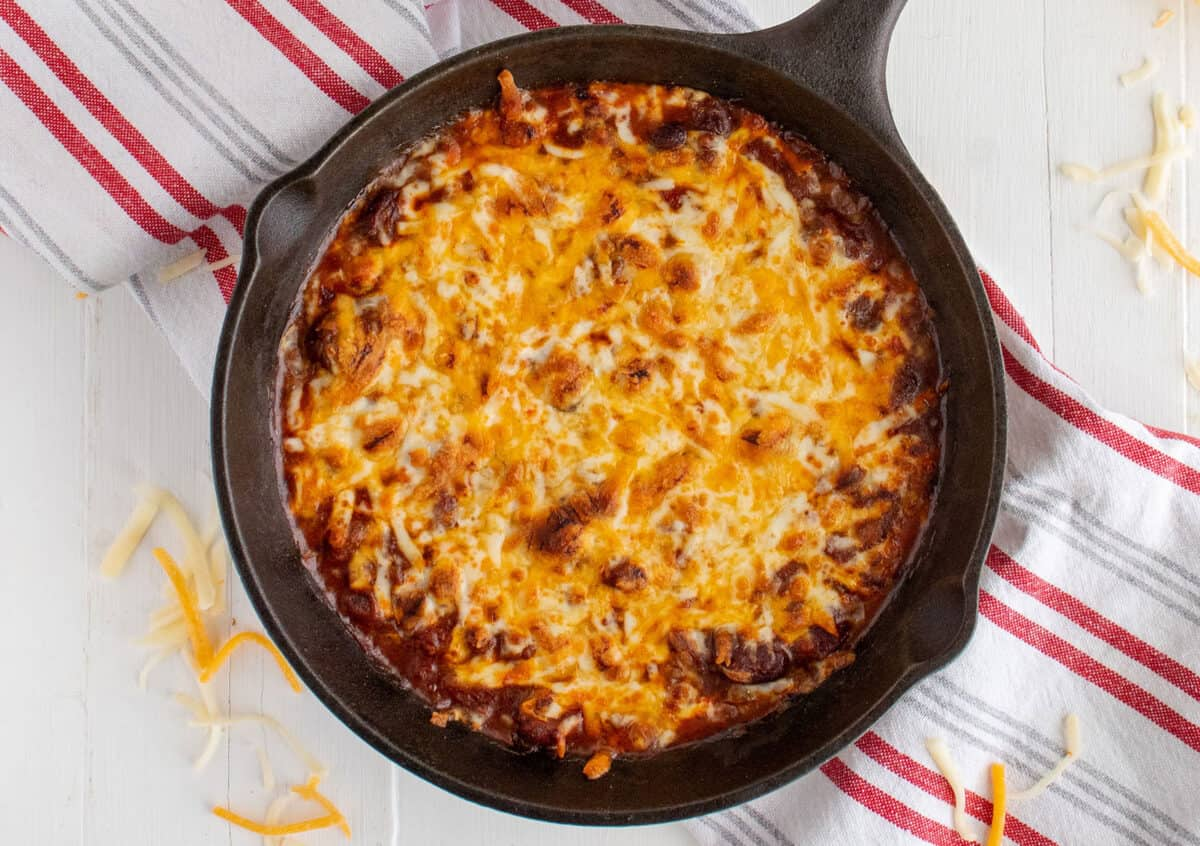 chili cheese dip in a cast iron pan