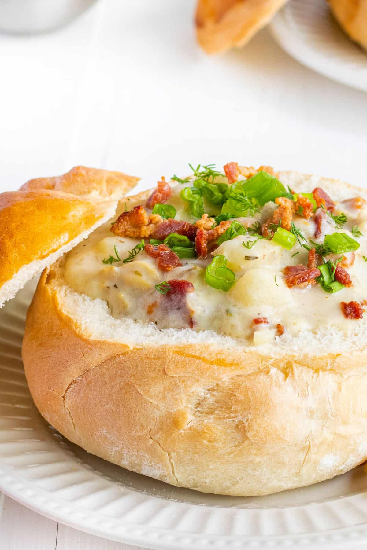 close up of New England clam chowder in a bread bowl