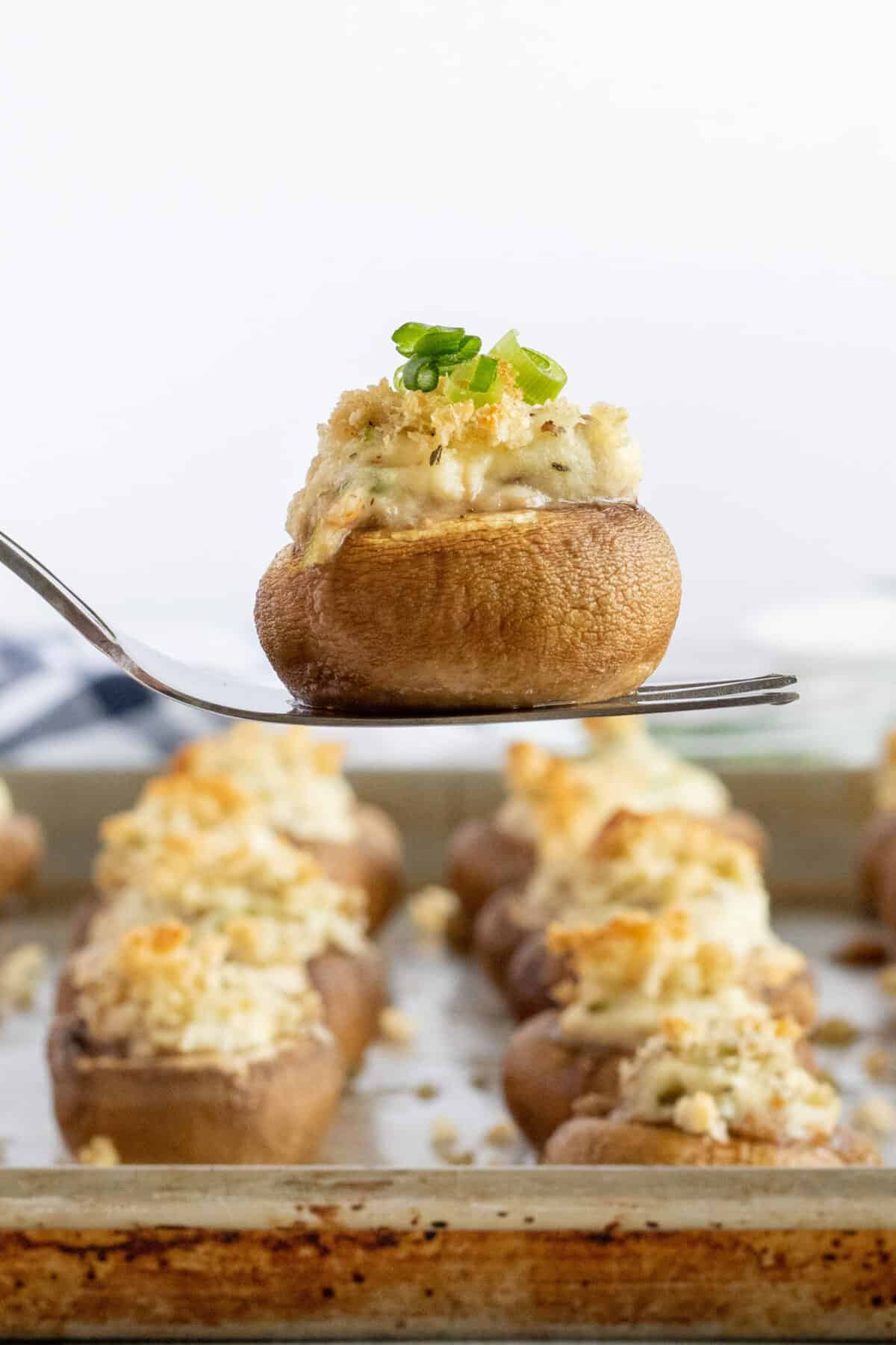 cran stuffed mushroom on a fork