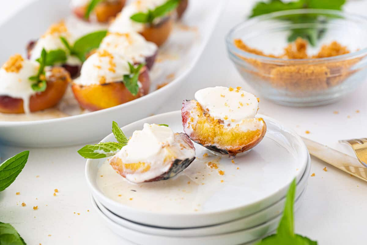 grilled peaches on a white plate
