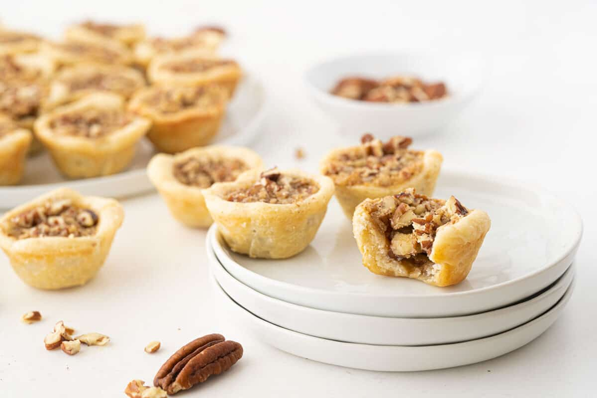 pecan tassies on a white plate