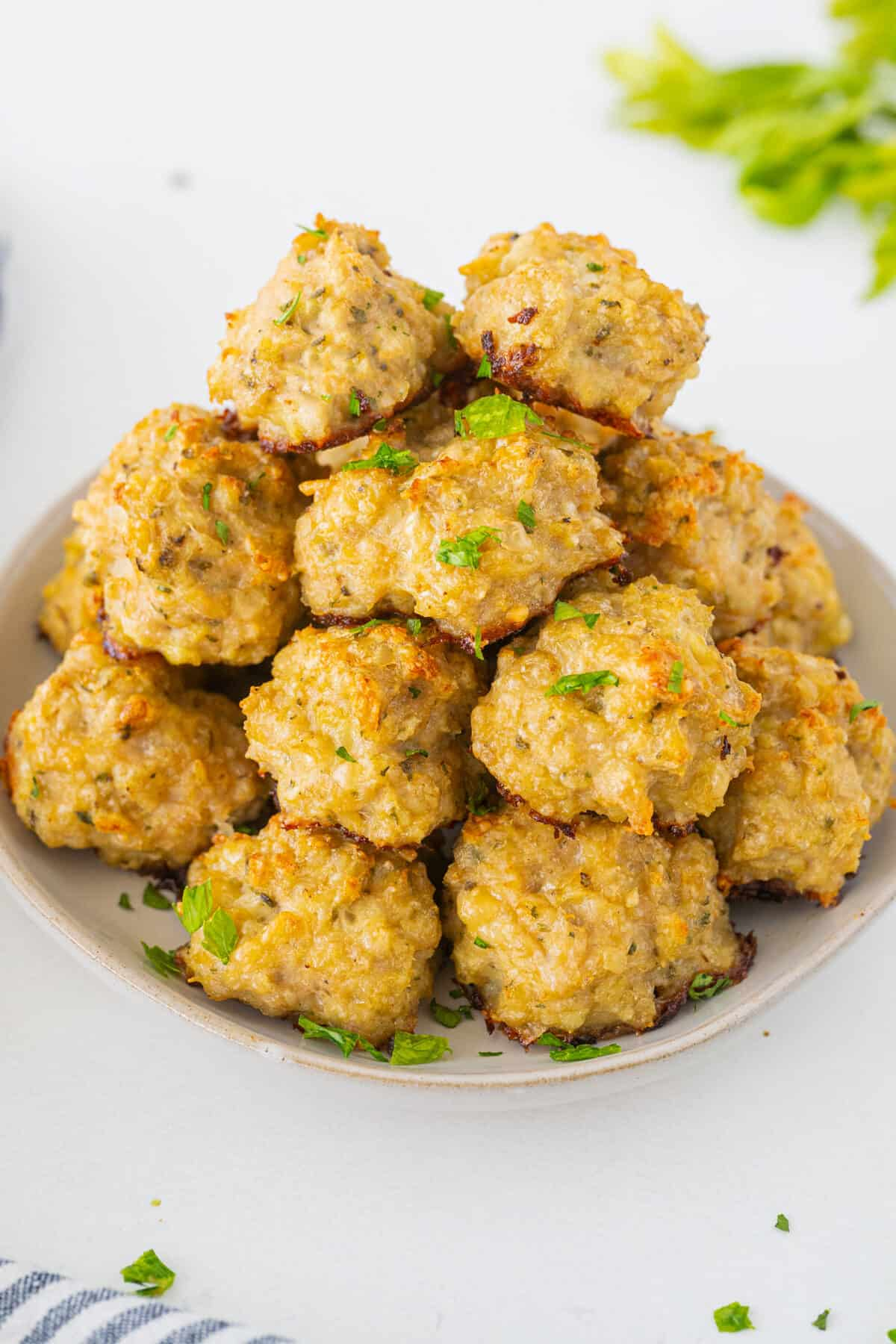 baked chicken meatballs on a white plate