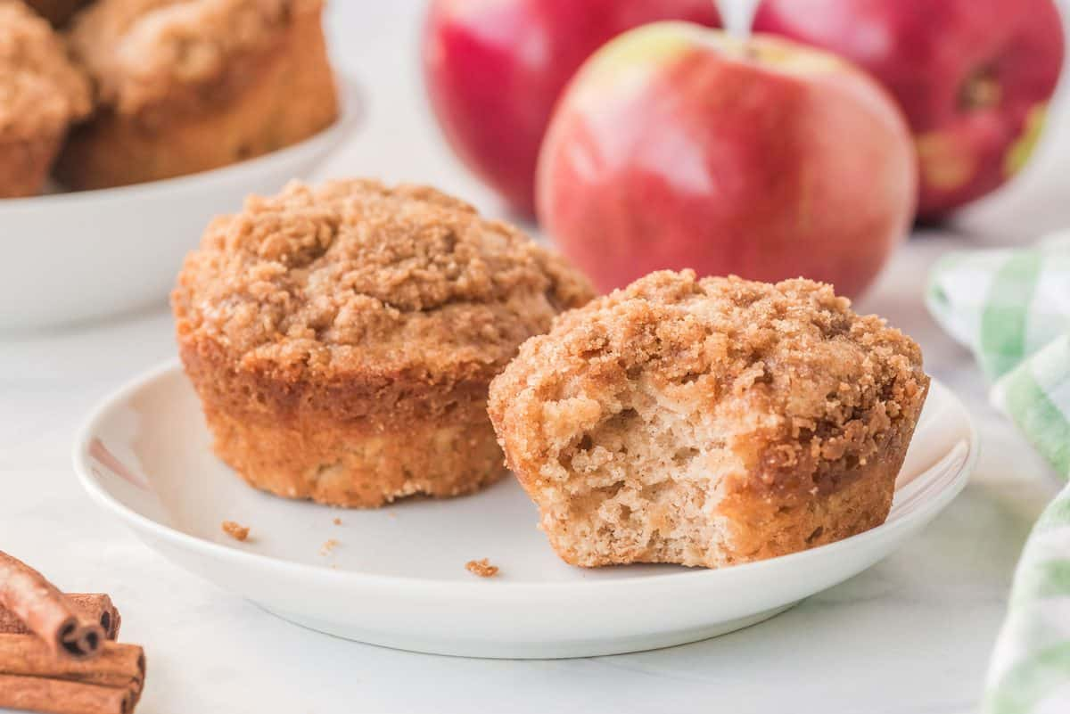 apple cinnamon muffins on a white plate