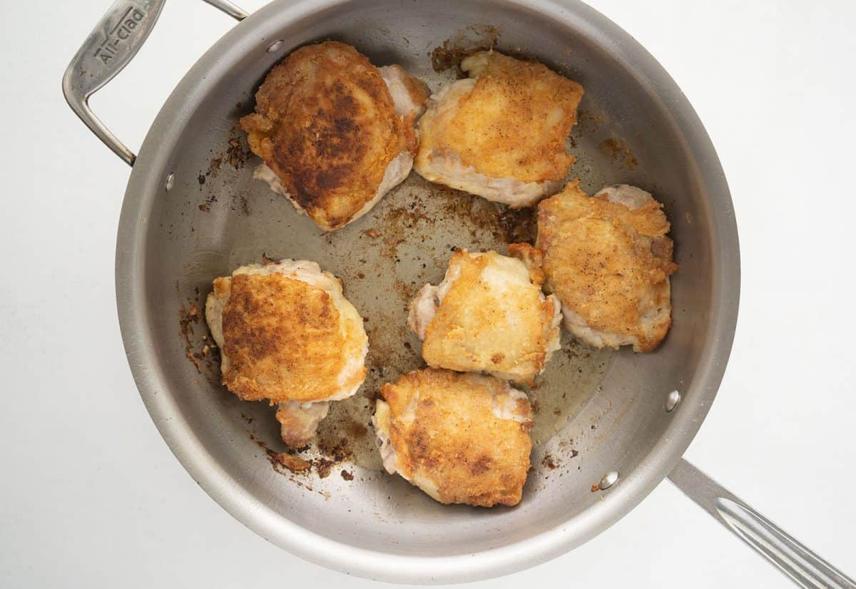 fried chicken thighs in a pan