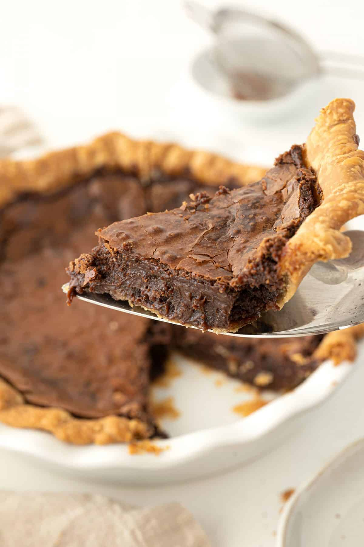 slice of chocolate chess pie on a pie server