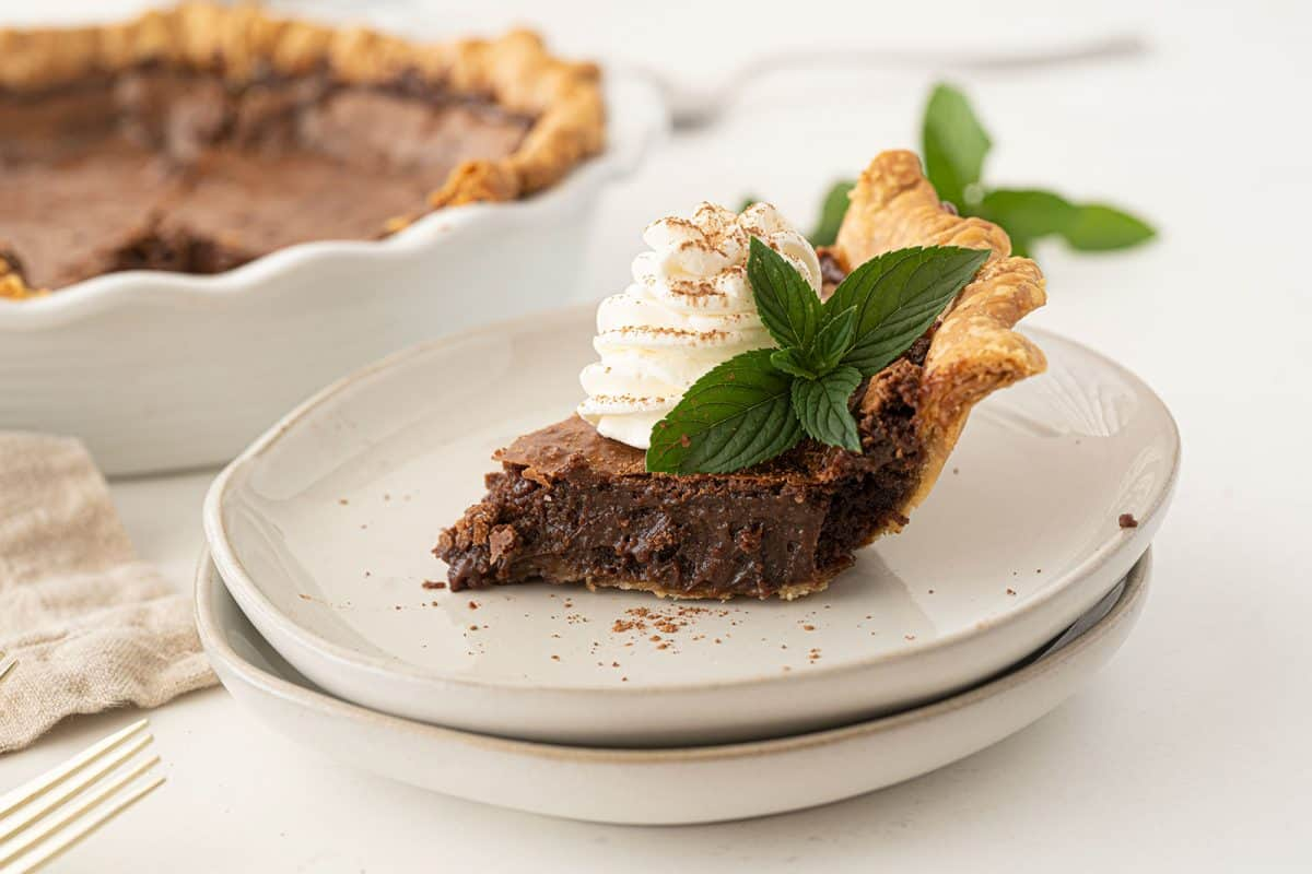 Chocolate chess pie on a white plate