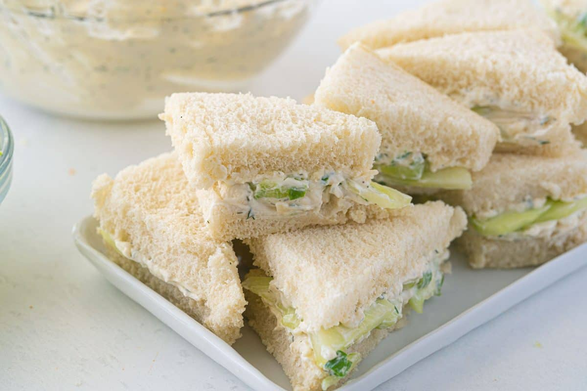a stack of cucumber sandwiches
