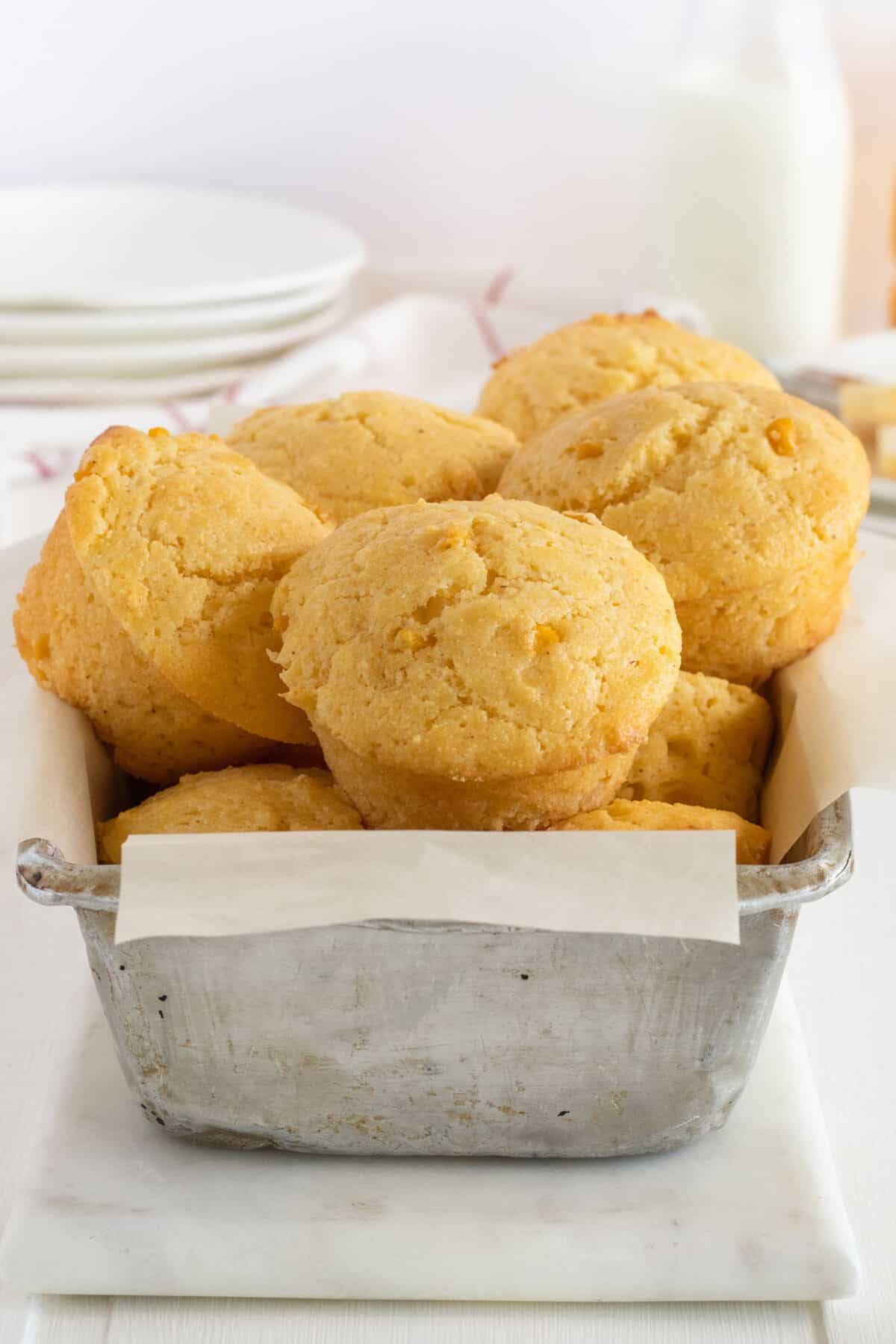 stack of cornbread muffins in a baking pan
