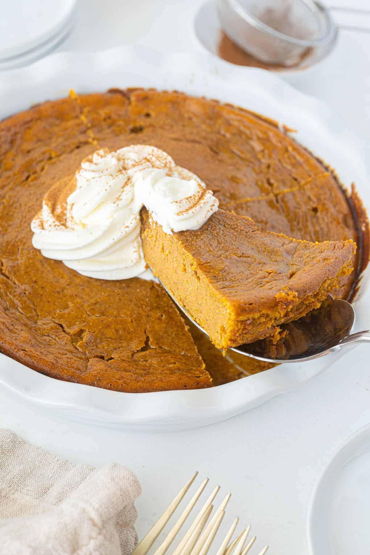 impossible pumpkin pie slice in a white pie plate